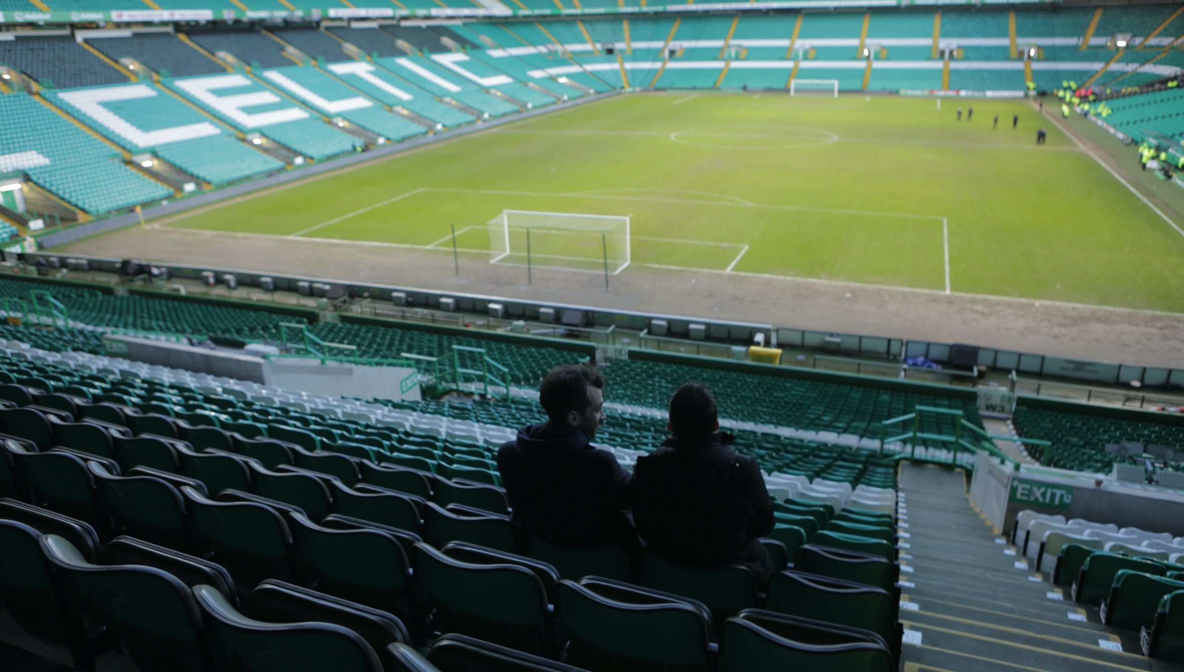 Photo of Jay Baruchel and Eoin O'Callaghan in a football stadium