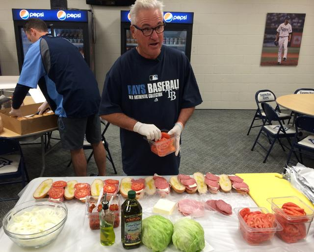 Joe Maddon makes his signature sandwiches for the team