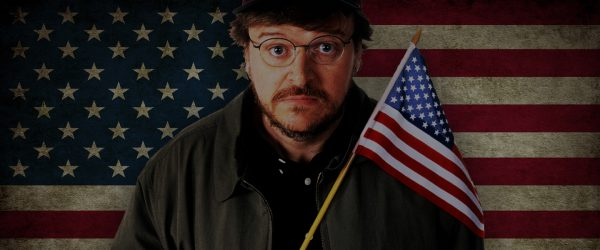Documentary filmmaker Michael Moore holds the American flag